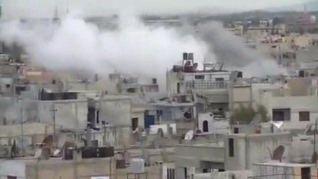 Smoke from buildings in Homs