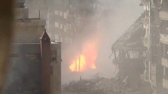 Unverified footage from Homs of shell making impact