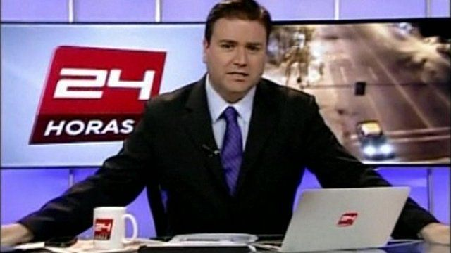 Cristian Pino reads the news during an earthquake
