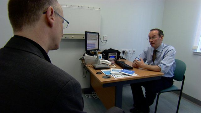 A patient receives his diagnosis from a doctor