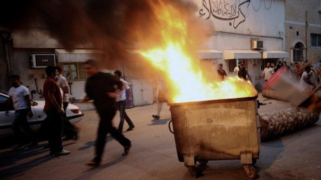Protesters clash with riot police in Manama