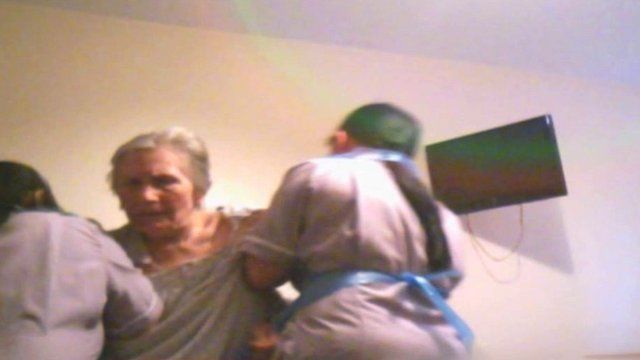 Secret filming of Maria Worroll, right, and care workers in Ash Court, London