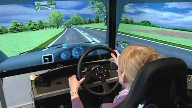 An older driver using a driving simulator