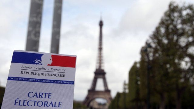 An electoral card in front of the Eiffel Tower