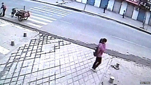 Girl in street on her phone