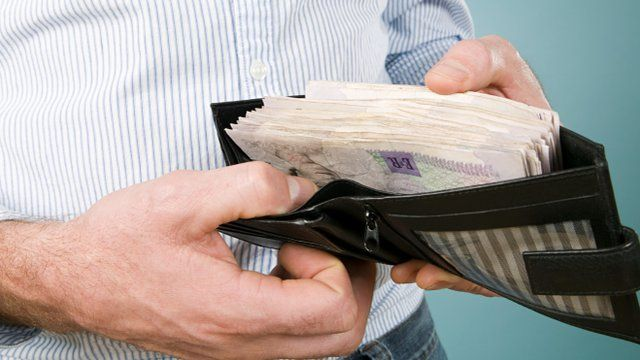 Man with cash in his wallet