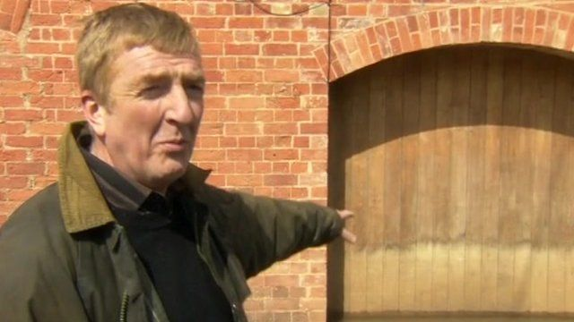 Tewkesbury resident points to flood line