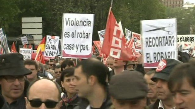 Spanish people demonstrate