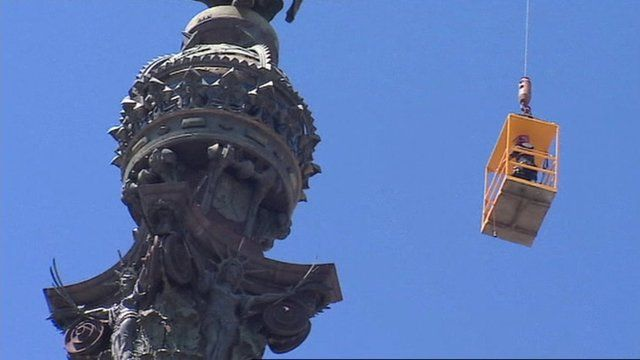 Firefighters in crane rescue tourists from top of Columbus monument