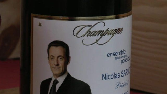 Champage bottlewith President Sarkozy's picture on the label