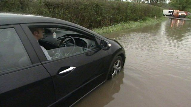 Driver trapped in Suffolk flooding