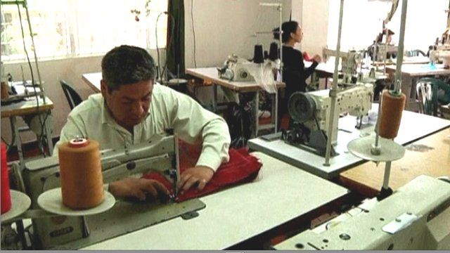 Alvaro Perez working on a sewing machine