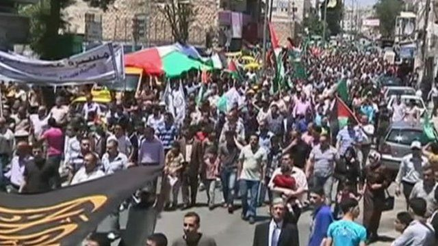 Palestinians marching in support of hunger strikers