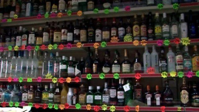 Bottles of alcohol on shop shelves