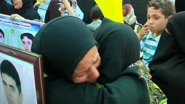 Two Palestinian women hug