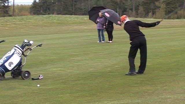 Darren Grey playing golf