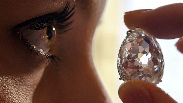 """Model poses with the Beau Sancy diamond during a Sotheby""""s auction press preview in Geneva"""