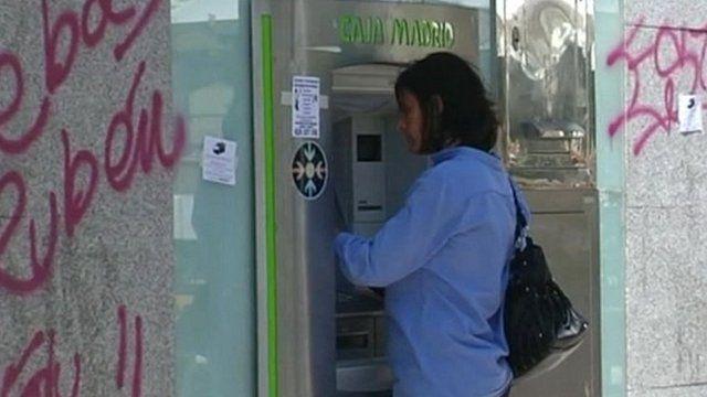 Woman at Spanish cash machine