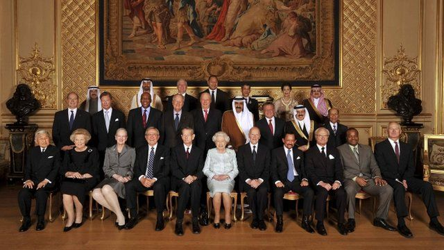 Queen Elizabeth poses for a photograph with sovereign monarchs