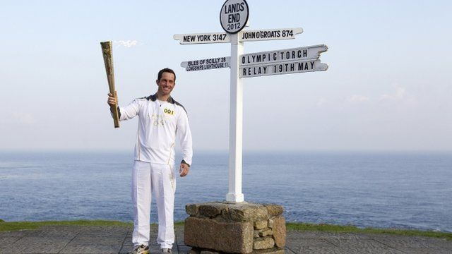 Ben Ainslie with the lit torch at Land's End