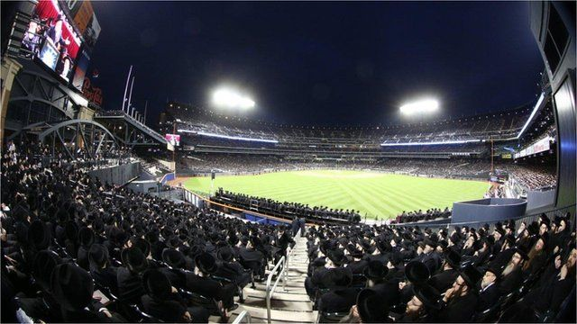 Orthodox Jews sit at Citi Field