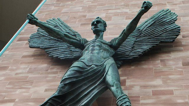 Statue on wall of Coventry Cathedral