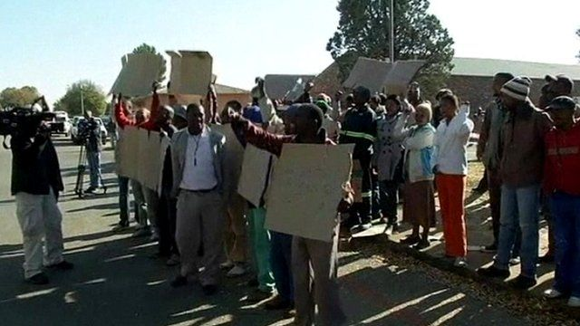 Protesters outside trial of men accused of murdering Eugene Terreblanche