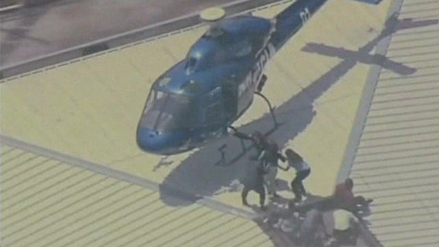 Helicopter rescuing workers from office fire