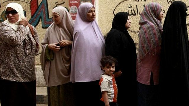 Voters waiting in a queue in Cairo