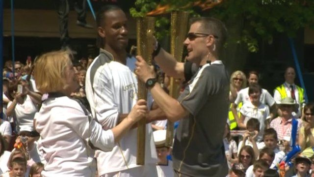 Chelsea striker Didier Drogba with the Olympic torch