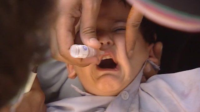 Boy being given polio drops