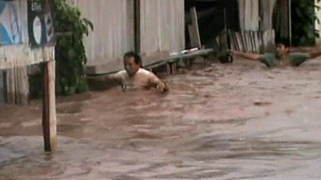 A man chest-deep in water