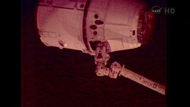 Station grabs SpaceX Dragon ship