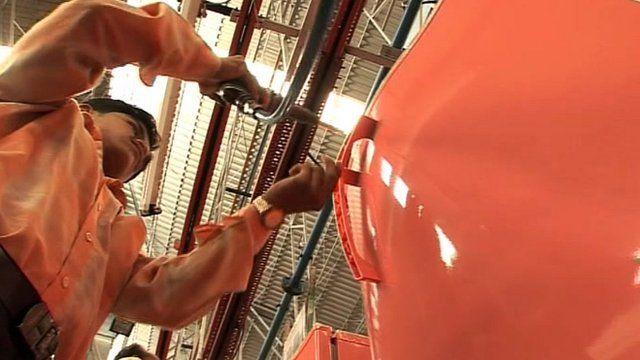 Worker assembling a fridge in India