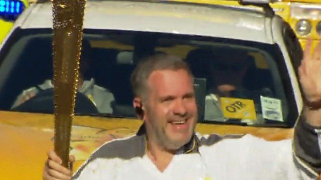 Chris Moyles carries Olympic torch through Aberystwyth