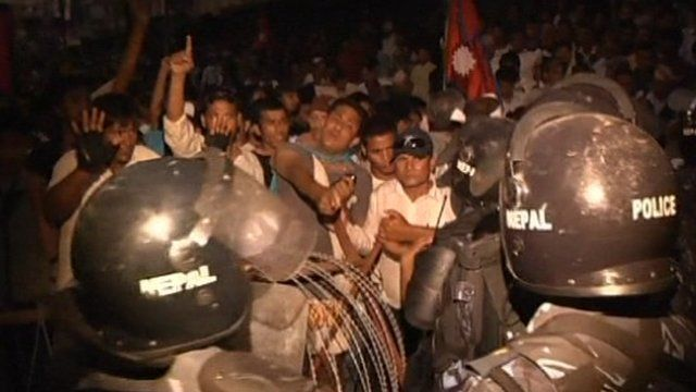Protesters clash with riot police in Kathmandu