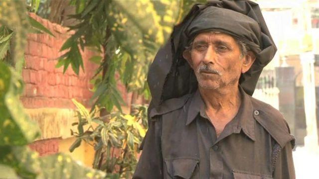 Tunni Rai, a security guard in India.