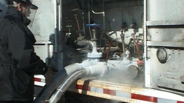 Worker at liquefied gas pump