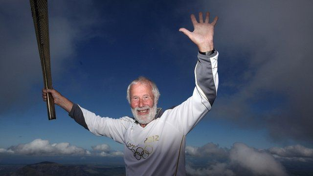 Sir Chris Bonington on the summit of Snowdon