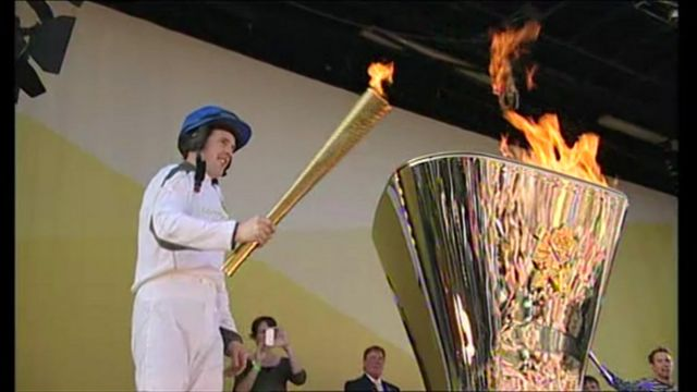 Champion jockey Jason Maguire with the Olympic torch