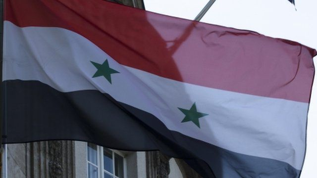 Syrian flags fly in front of the Syrian embassy in Berlin
