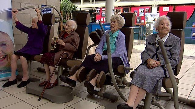Centenarian women using exercise equipment