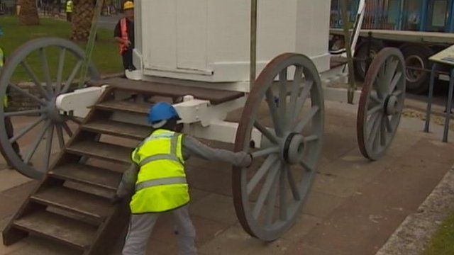 A replica of a royal bathing machine being moved on to Weymouth seafront
