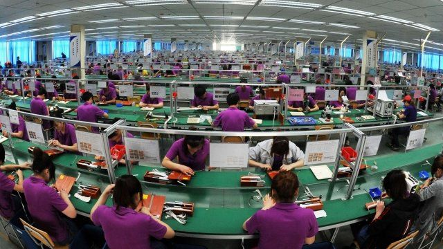 Chinese labourers work at an electronic products factory in Bozhou, east China's Anhui province