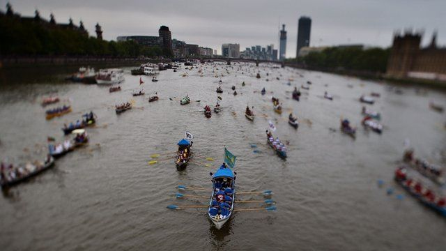 Rowing boats taking part in The Diamond Jubilee Thames Pageant