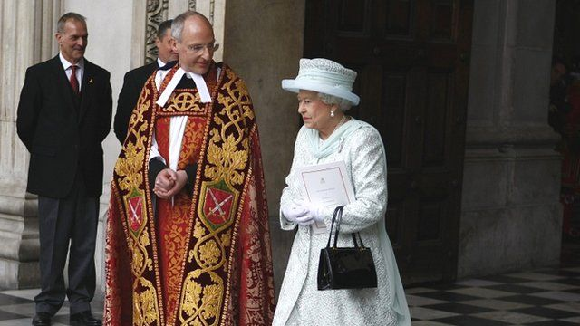 Queen Elizabeth II leaves St Paul's Cathedral with the Dean of St. Paul's David Ison