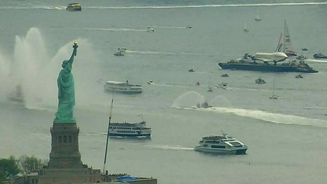 Statue of Liberty and Space Shuttle Enterprise on a barge