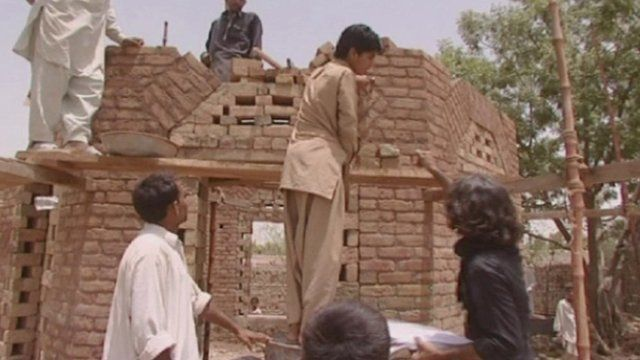 Villagers constructing mosque in Pakistan