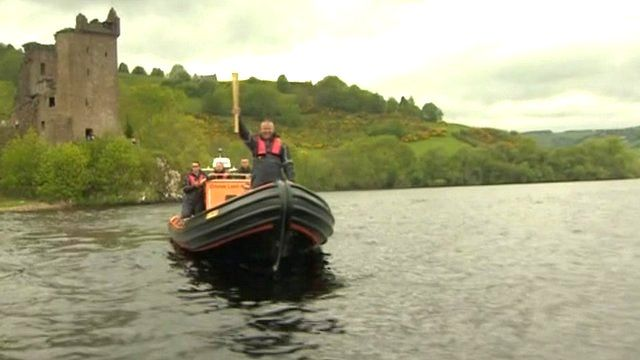 The Olympic torch is carried on a boat