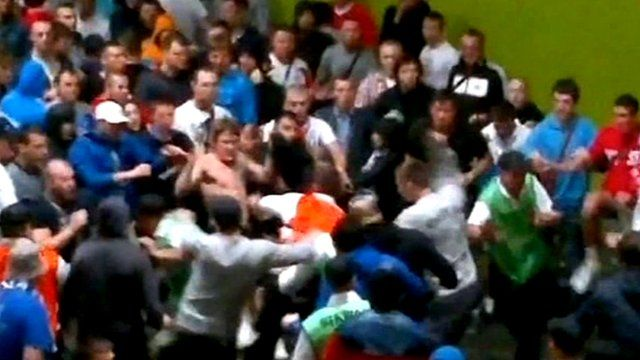 Scuffle between fans and stewards